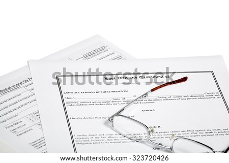 Last will and testament with individual income tax return and reading glasses isolated on white