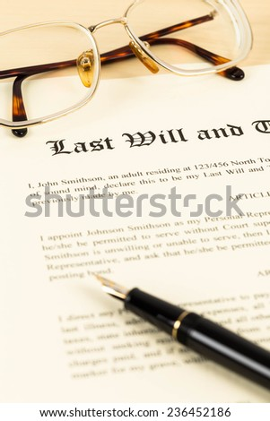 Last will on cream color paper with glasses and pen concept for legal document - stock photo