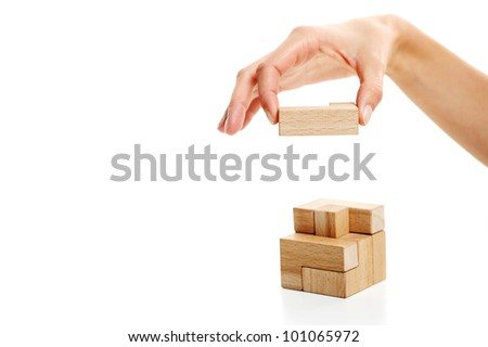 Last wooden puzzle piece. white background - stock photo