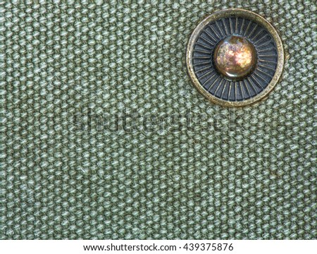 latch button on the canvas bag - stock photo