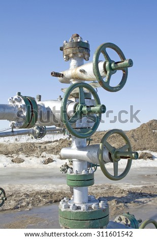 Latch on a gas pipe. Gas industry. Oil industry. Construction and equipment in work. - stock photo