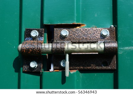 Latch on a metal shed door - stock photo