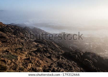 Late afternoon fog rolls in towards the coast of Northern California in Mendocino. This rugged region is one of the west coast's most beautiful areas. - stock photo