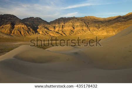 Late afternoon light and color on the rocks on the last chance mountains rising above Eureka Dunes, Death Valley National Park, California, United States
