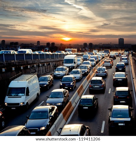 Late afternoon traffic. Traffic jam. Cars. Urban scene. - stock photo