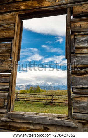 "Late afternoon view of the Tetons from inside the abandoned cabin that was used for filming the movie ""Shane"" - stock photo"