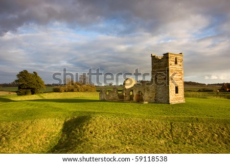 Late autumn sunshine on the remains of the medieval church at Knowlton, Dorset, UK