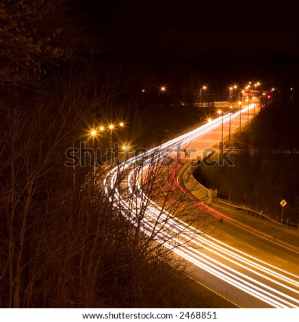 Late night light streaks from traffic on the freeway - stock photo