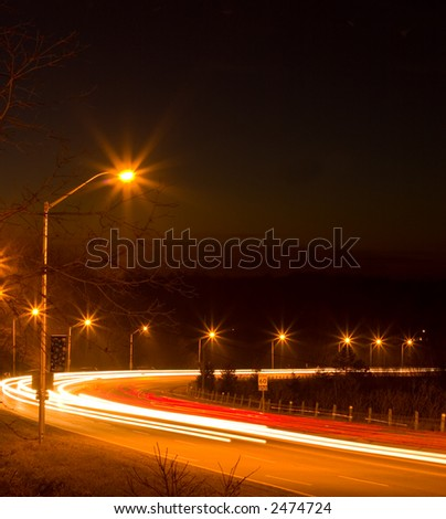 Late night on a freeway with lights like streams