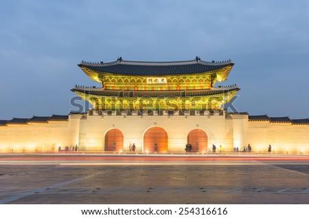 Late night traffic blurs past Gyeongbokgung Palace in Seoul,South Korea - stock photo