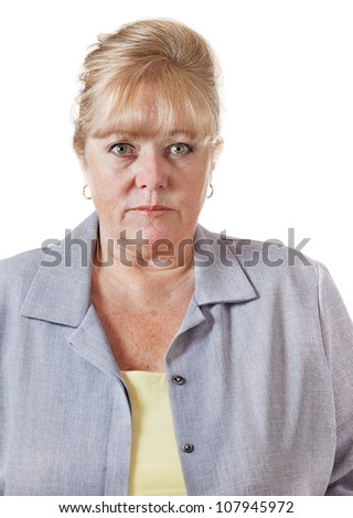 Late 50s woman with hair up, comfortable looking her age - stock photo