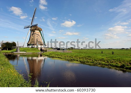 Late summer time a Windmill in the Netherlands countryside