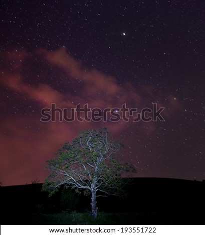 Late sunset with stars and clouds - stock photo