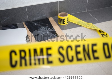 latent footprint evidence with blurred crime scene tape - stock photo