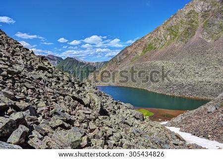 Lateral moraines and small ribbon lake. Eastern Sayan.The Republic of Buryatia - stock photo