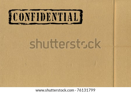 Lateral wall of a cardboard box with an information inscription - stock photo