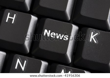 latest internet news concept with a black button on computer keyboard - stock photo