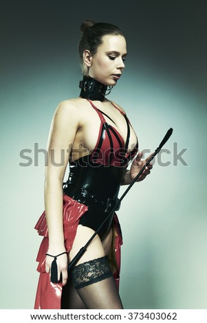 Latex beauty in studio with crop - stock photo