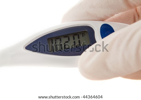 Latex Gloved Hand Holding An Instant Read Thermometer