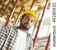 latin american construction worker looking at camera. - stock photo