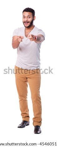 Latin american man pointing at you with both hands. White background isolated. Full length portrait. - stock photo