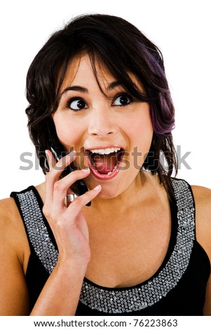 Latin American woman talking on a mobile phone isolated over white