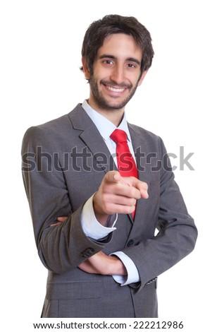 Latin businessman with beard laughing at camera - stock photo