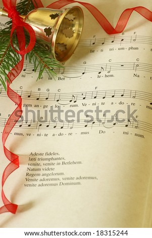 Latin carol Adeste fideles and Christmas decorations