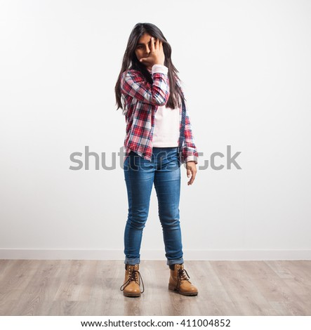 latin girl covering her eye - stock photo