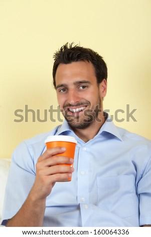 Latin man drinking coffee  - stock photo