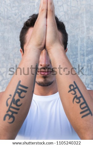 Latin man practicing meditation tattoos sanskrit stock photo edit latin man practicing meditation tattoos in sanskrit meaning ahimsa non violence and thecheapjerseys Choice Image