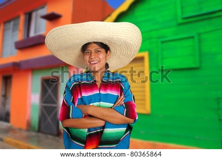 Latin mexican hispanic woman with sombrero and poncho in colorful Mexico house [Photo Illustration]