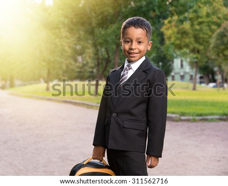 latin primary school student on the park valley - stock photo