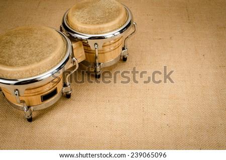 Latin Wooden Bongo on brown sack background - stock photo