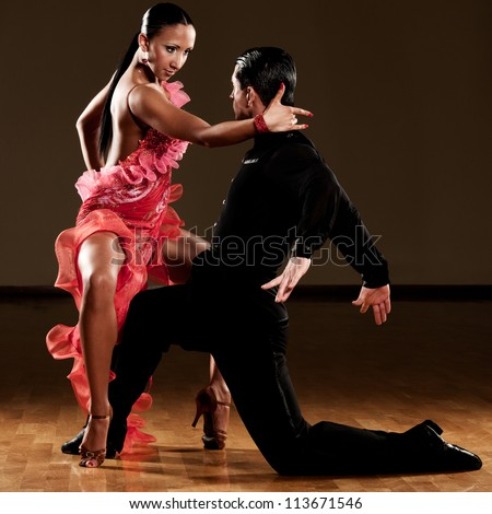 latino dance couple in action - wild pasodoble - stock photo