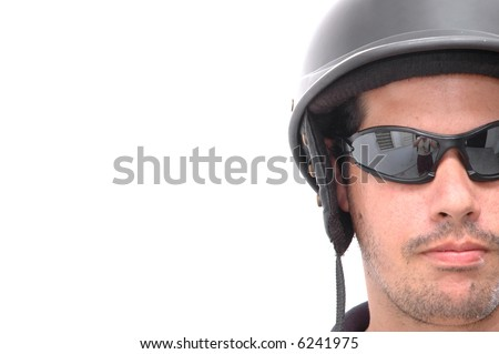 Latino motorcycle man wearing a black  motorcycle helmet and dark sunglasses - isolated - stock photo