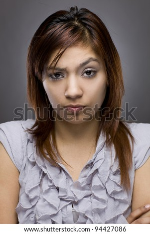 latino woman looking mad - stock photo