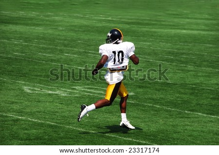 LATROBE, PA - JULY 29, 2008: Santonio Holmes of the Pittsburgh Steelers team running at training camp at St. Vincent College in Latrobe Pennsylvania for the 2008 2009 football season July 29, 2008.
