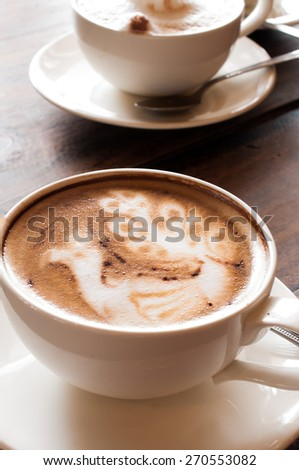 Latte' Art Coffee,Cup of latte coffee on wooden background - stock photo