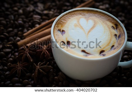 latte art coffee on coffee beans background - stock photo
