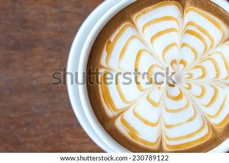 Latte coffee art with caramel - stock photo