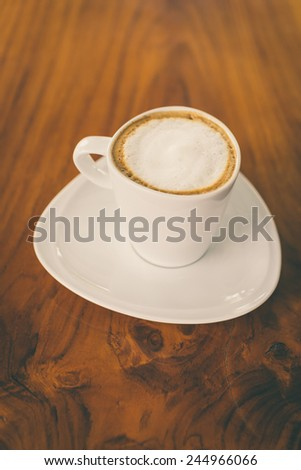 Latte coffee cup in coffee shop - process vintage effect style pictures - stock photo