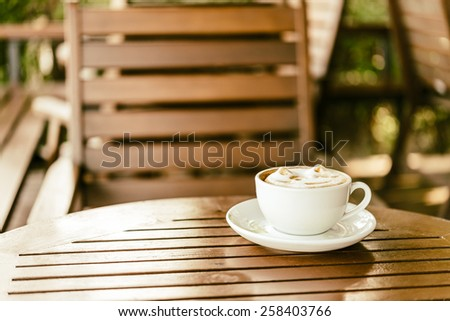 Latte coffee mug on wooden table - vintage effect style pictures