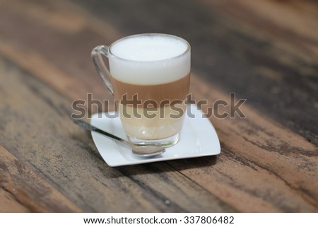 latte coffee or caffe latte on wooden table - stock photo
