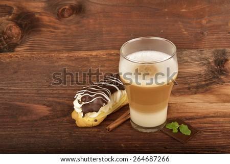Latte macchiato and eclair - stock photo