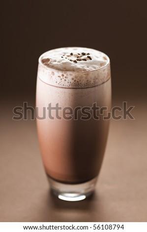 Latte macchiato in tall glass close up - stock photo