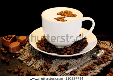 Latte on wooden table on brown background - stock photo