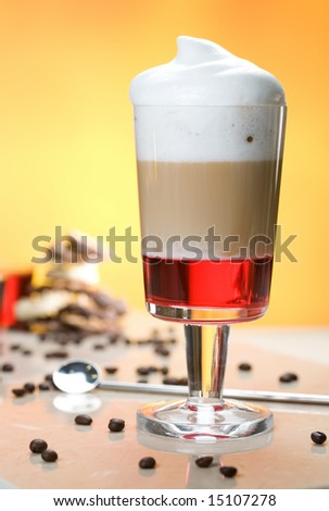 latte with cream and strawberry syrup - stock photo