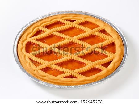 Lattice topped apricot tart in tin foil pan - stock photo