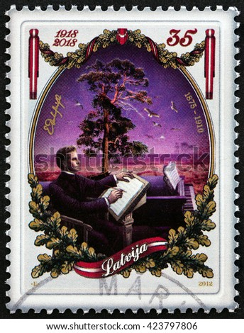 """LATVIA - CIRCA 2012: A stamp printed in Latvia from the """"100th anniversary of the Republic of Latvia """" issue shows composer Emils Darzins, circa 2012. - stock photo"""